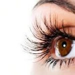 a woman's long lashes and eye