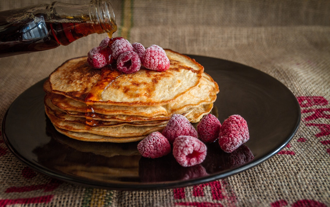 Golden Banana Pancakes with Fresh Raspberries